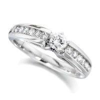 Platinum Ladies Half Carat Brilliant Cut Diamond Engagement Ring with Solitaire Diamond and Channel Set Shoulders